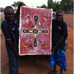Community members with the original painting that inspired the logo for Good Food Systems  project, led by Menzies School of Health research.  l