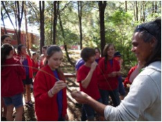 Local Indigenous mentor to the Silkwood program with students tasting sugar bag honey...